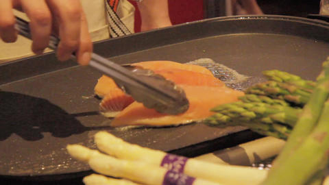 Salmon cooking on grill, cooked Japanese style Live Action