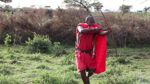 Maasai warrior hunting with a bow Footage