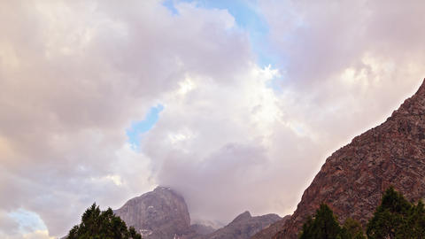 Peaks In The Clouds At Sunset. Pamir, Tajikistan.  stock footage