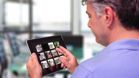 Businessman Browsing iPad Gallery AE Version 5 - 2