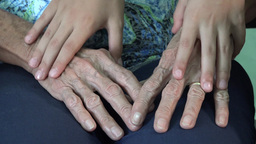 Young Child Hands Rubbing Her Grandmother Hands stock footage