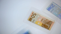 Throwing Foiled Euro Banknotes On White Background stock footage