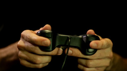 Playing Games On Joystick/gamepad stock footage