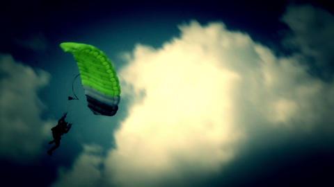 Guy on parachute lands Live Action