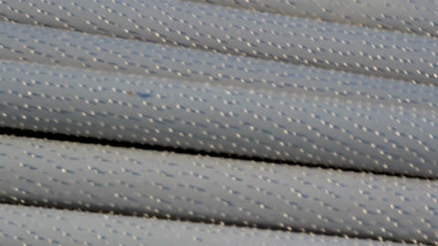 An up-close image of steel pipes piled Footage