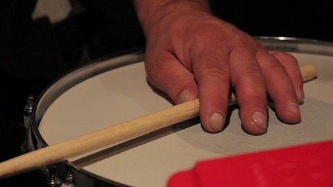 Drumsticks playing to the rhythm Live Action