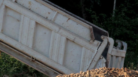 Dumping of soil using the dump truck and truckload Footage