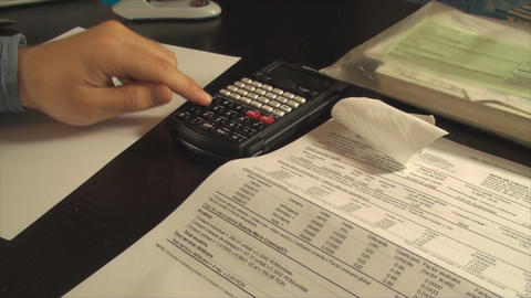 Young Accountant Hands Calculating Taxes Late At N stock footage