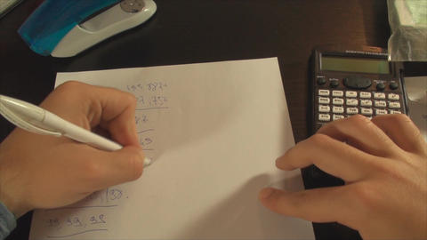Young Accountant Hands Calculating Taxes Late At N Footage