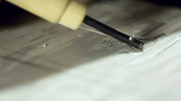 Creative Artist Cutting Out Linoleum 06 stock footage