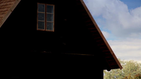 Large and Brown wooden tar colored shingle roof ho Footage
