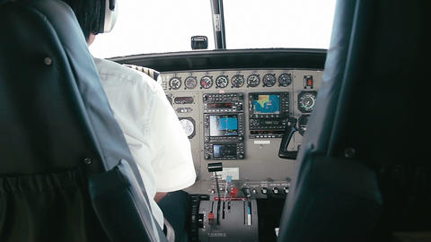 1080p, Pilot Handles Instruments In Airplane stock footage