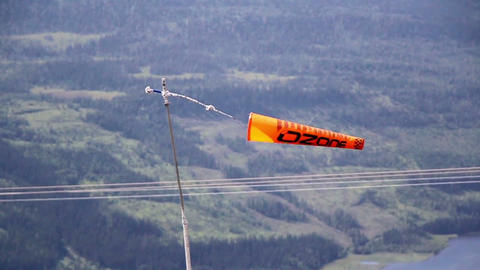 Orange banner flag tied to a pole while swaying mi Footage