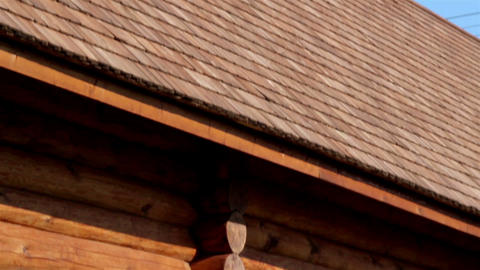 Brown colored log house wall with tar oiled cedar  Footage