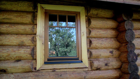 Glass window reflection on the cabin log house Footage