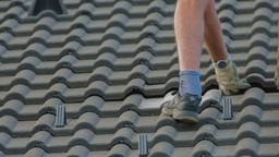 Aligning Roof Tiles After Replacing Broken Ones stock footage