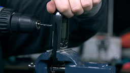 Close Up Of Drilling A Hole Through Mobile Phone I stock footage