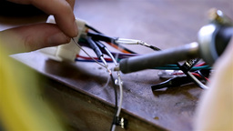 Soldering Wires On Car Radio Module stock footage