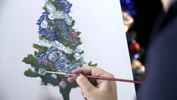 Drawing Christmas Tree Ornaments On Canvas stock footage