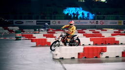 Wide Shot Of Motor Jumping On Small Jump stock footage