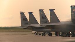 HD2009-6-6-33 apron F15 line jet landing in bg Footage