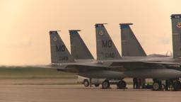 HD2009-6-6-33 apron F15 line jet landing in bg Stock Video Footage