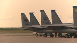 HD2009-6-6-33 apron F15 line jet landing in bg Stock Video Footage