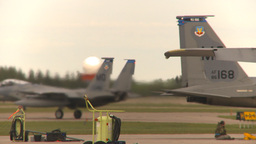 HD2009-6-6-47 F15 taxis between aircraft Stock Video Footage