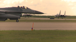 HD2009-6-6-51 F15s taxi F16 pulls up Stock Video Footage