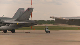 HD2009-6-7-5 Challenger taxi past F18s Stock Video Footage