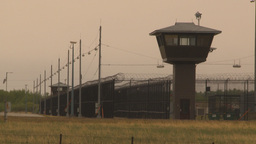 HD2009-6-7-23 prison fence and towers Stock Video Footage