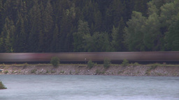 HD2009-6-8-15 train on river tl slow Stock Video Footage