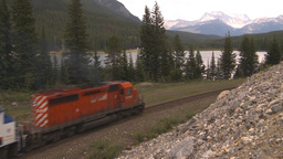 HD2009-6-10-5 passenger train lake mtns Stock Video Footage