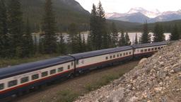 HD2009-6-10-5 passenger train lake mtns Stock Video Footage
