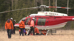 HD2009-6-11-29RC 60i Banff Heli rescue on ground Stock Video Footage