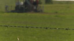 HD2009-6-19-8 pumpjack barb tilt up rack focus Stock Video Footage