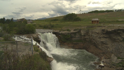 HD2009-6-20-14 Lundbreck falls and wind turbine Stock Video Footage