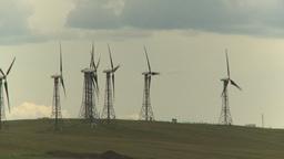 HD2009-6-20-30 wind turbines on ridge Stock Video Footage