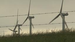 HD2009-6-20-38 wind turbines on ridgebarb wire Stock Video Footage