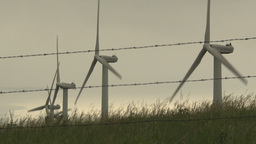 HD2009-6-20-38 wind turbines on ridgebarb wire Stock Video Footage