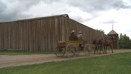 HD2009-6-24-5 western horse and buggy passes log fort Stock Video Footage