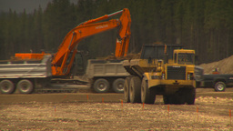 HD2009-6-22-7 backhoe and const traffic LLL Stock Video Footage