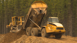 HD2009-6-22-9 dump truck and dozer LLL Stock Video Footage