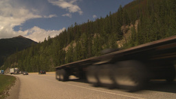 HD2009-6-22-13 transport trucks mountains Footage