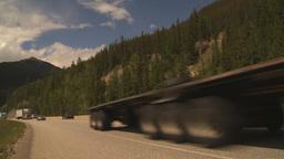 HD2009-6-22-13 transport trucks mountains Footage