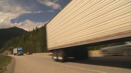 HD2009-6-22-13 transport trucks mountains Stock Video Footage