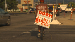 HD2009-6-27-1 religous old guy on bike with sign Stock Video Footage