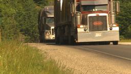 HD2009-6-27-5 TN trucks on mountain highway Stock Video Footage
