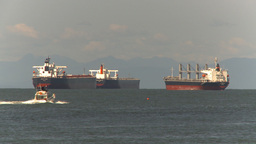 HD2009-6-31-6 pleasure boat passes cargo ships Stock Video Footage