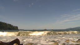 HD2009-6-31-14 tug boat cargo ships in distance waves crash Stock Video Footage